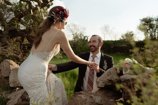 Groom and bride smiling touching their foreheads