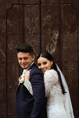 Groom and bride hugging and smiling