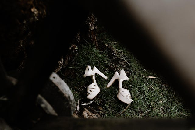 Bridal shoes set in the garden lawn
