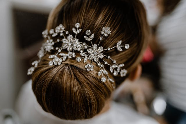 Hairstyle and headdress detail for bride