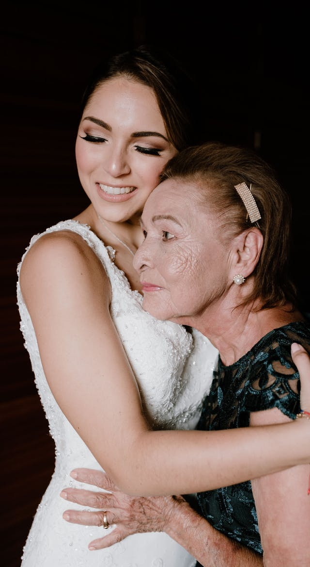 The bride hugging her grandmother on her wedding day
