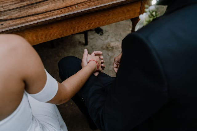Groom and bride holding hands at their wedding