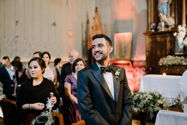 Groom waiting for his fiancee at the altar