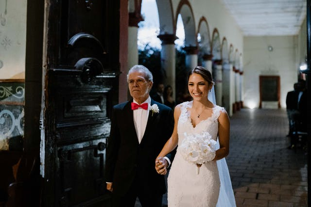Bride walking with her dad to the altar