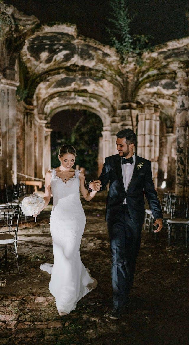 Groom and bride walking at night at Hacienda Santa Lucia