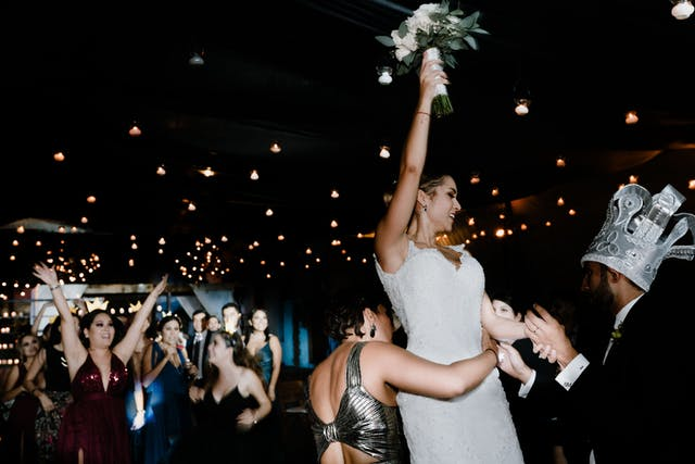 Bride throwing the bouquet to her bridesmaid